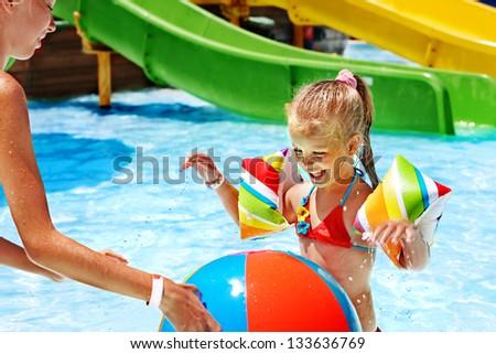 Child on water slide at aquapark. Summer holiday. - stock photo