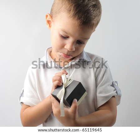 Child opening a little present