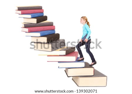 child or girl climbing a staircase of books, isolated on white - stock photo