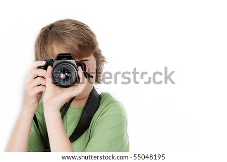 child or teen boy with slr camera - stock photo