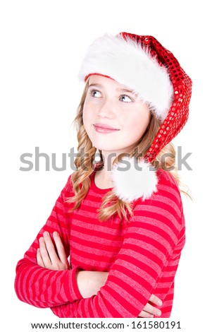 Child or teen girl wearing a Santa hat on an isolated white background - stock photo