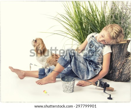 Child or young girl with her dog taking a nap or sleeping while fishing, painterly style with vintage filter applied. - stock photo