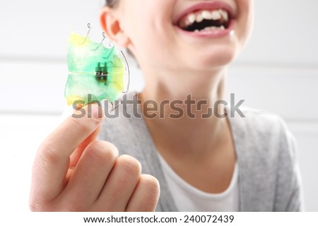 Child orthodontist. Portrait of a little girl with orthodontic appliance  - stock photo