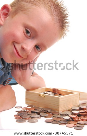 child over chest of coins, isolated on white. - stock photo
