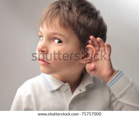 Child overhearing something - stock photo