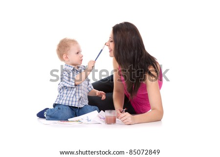 child paint on mother face isolated over white background - stock photo