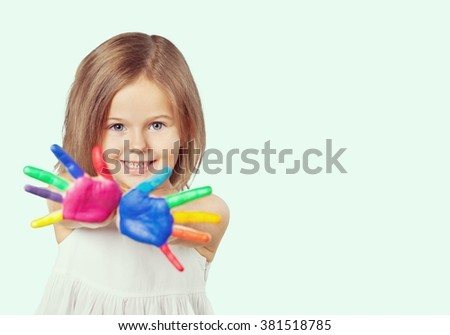 Child painted hands. - stock photo