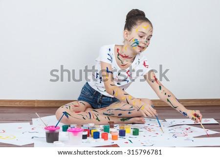 Child painting. - stock photo