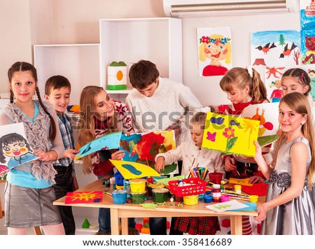 Child painting at art school. - stock photo