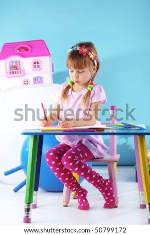 Child painting in her nursery at home - stock photo