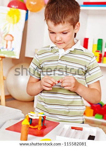 Child painting  in school. Education. - stock photo