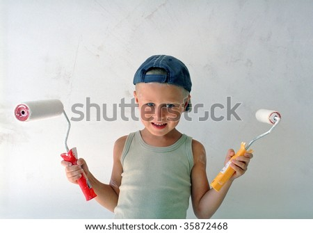 child painting wall - stock photo