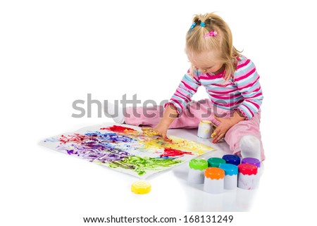 Child painting with fingers isolated on white  - stock photo