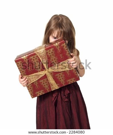 Child Peeking Over Christmas Package - stock photo