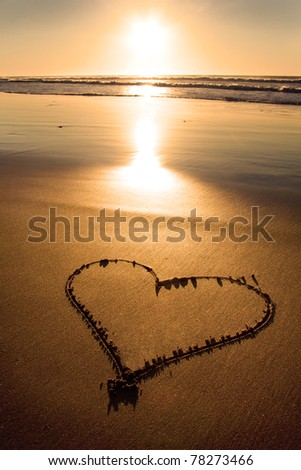 Child picture drawn in the sand on the atlantic coast - stock photo