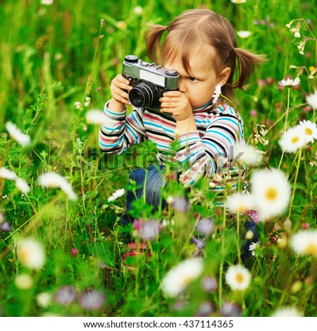 Child pictures of flowers on the meadow. - stock photo