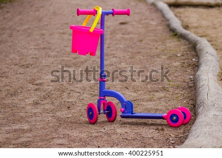 Child pink scooter - stock photo