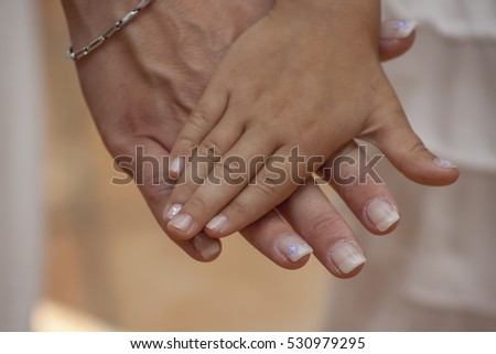 Child placed hand in mothers hand