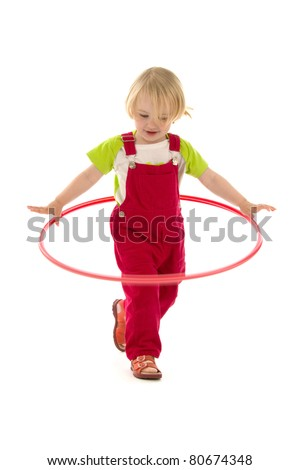 Child plaies with hula hoop,on white background. - stock photo