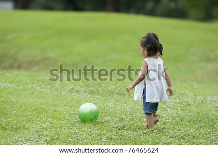 child play ball in park - stock photo