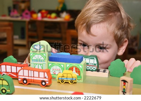 child play in kindergarten - stock photo