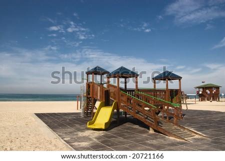 child playground  on the beach - stock photo