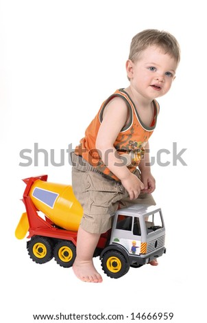 child playing a truck car
