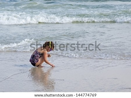 Child playing at the beach.