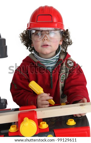 Child playing builder - stock photo