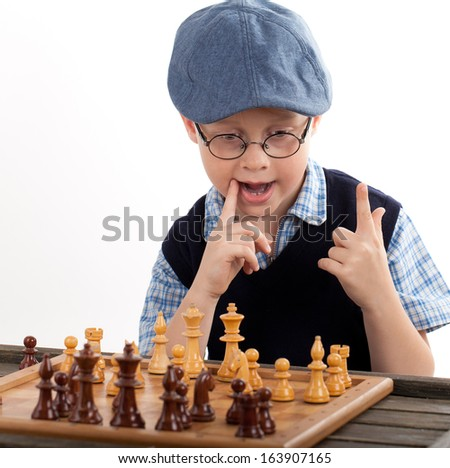 Child playing chess, isolated on white background  - stock photo