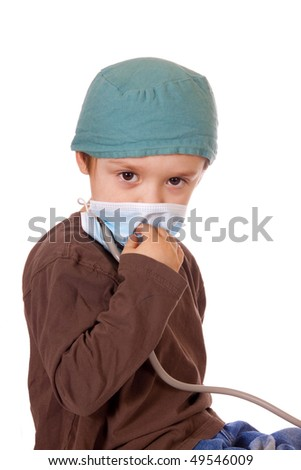 Child playing Doctor with  mask on