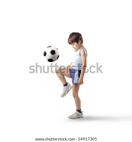 Child playing football - stock photo