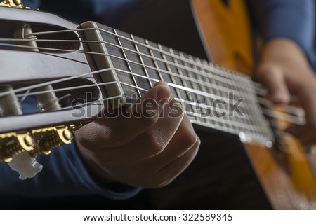 Child Playing Guitar Close up   - stock photo