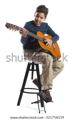 Child Playing Guitar on Chair - stock photo