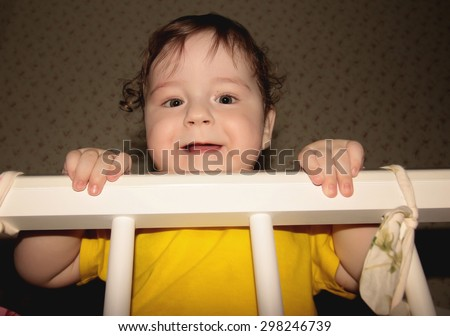 child playing in bed - stock photo