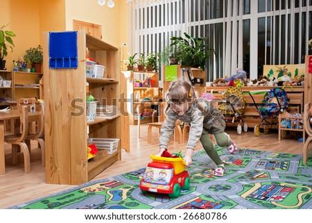 Child playing in kindergarten - stock photo