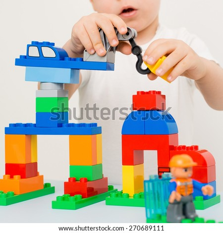 child playing in the constructor - stock photo