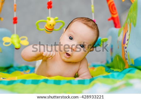 child playing lying in Mobile - stock photo