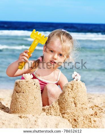 Child playing on beach. - stock photo
