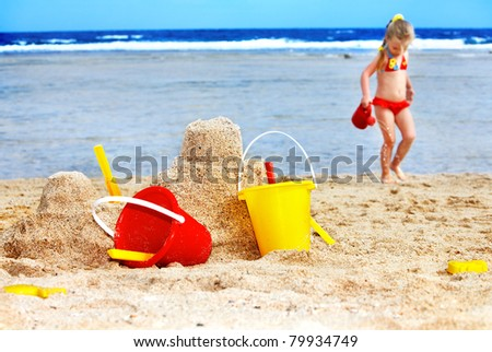 Child  playing on  beach with ball. - stock photo