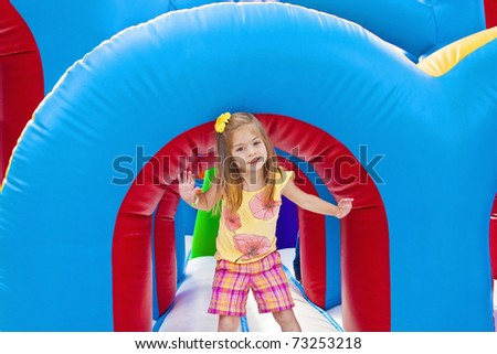 Child playing on Inflatable Playground - stock photo