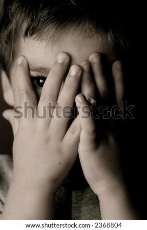 Child playing peek-a-boo - stock photo