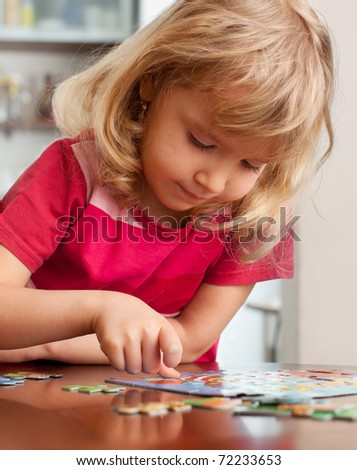 Child, playing puzzles at home