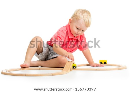 child playing rail road toy - stock photo