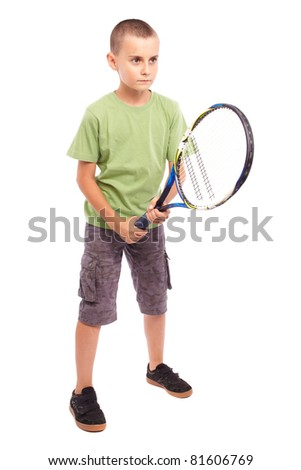 Child playing training with a field tennis raquet, studio full length portrait