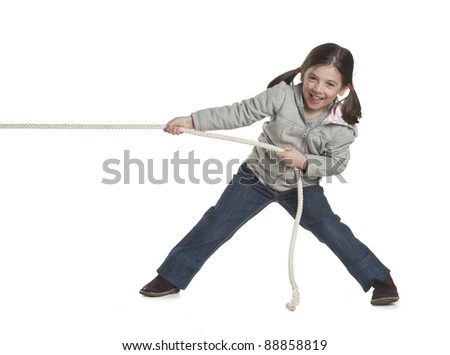 child playing tug of war - stock photo