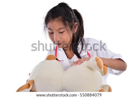 Child playing veterinarian with dog doll