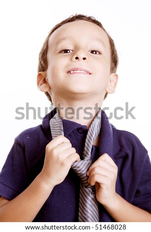 Child playing with a tie as a businessman