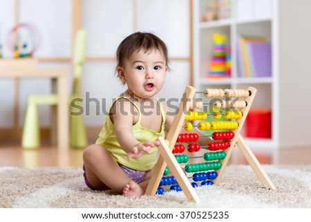 child playing with abacus - stock photo