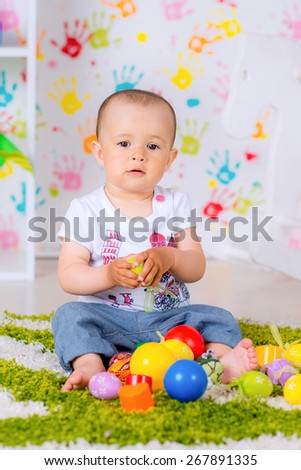child playing with balloons at home